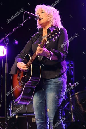 Stock Picture of A US Grammy Award winning Country music star, Lucinda Williams performs on Day Two of the world renowned Cambridge Folk Festival at the Cherry Hinton Hall in Cambridge.