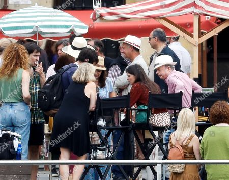 Elena Anaya (2-R) and US actor Wallace Shawn (R) rest during the shooting of the new movie of US filmmaker Woody Allen (unseen) in Pasajes de San Juan town, Gipuzkoa, Basque Country, northern Spain, 05 August 2019. Allen started filming his new movie in Spain on 10 July.