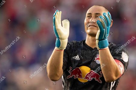 New York Red Bulls goalkeeper Luis Robles applauds fans at the end of the team's MLS soccer match against Toronto FC, in Harrison, N.J. The Red Bulls won 2-0