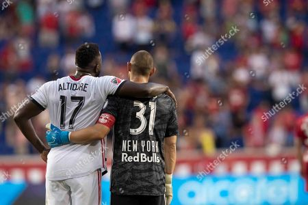 Jozy Altidore, Luis Robles. Toronto FC forward Jozy Altidore (17) and New York Red Bulls goalkeeper Luis Robles (31) embrace at the end of their MLS soccer match, in Harrison, N.J. The Red Bulls won 2-0