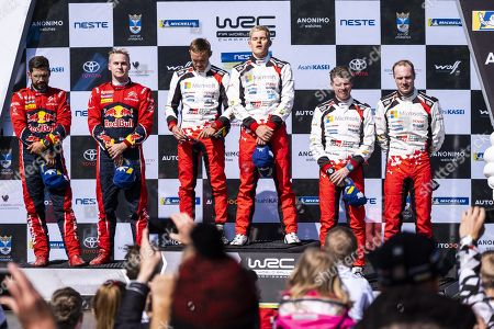 Second placed Finnish driver Esapekka Lappi and co-driver Janne Ferm, winner Estonian driver Ott Tanak and co-driver Martin Järveoja and third placed Finnish driver Jari-Matti Latvala and co-driver Miikka Anttila celebrate on the final podium of the Neste Rally