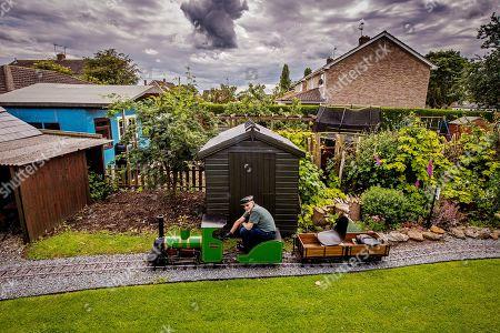 Editorial image of Steve Bates, who has built a miniature steam railway in his back garden, Waddington, Lincolnshire, UK - 20 Jun 2019