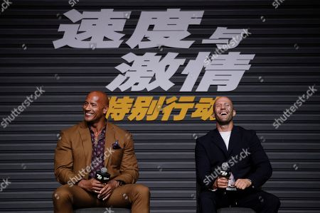 Jason Statham, Dwayne Johnson. Actors Jason Statham, right, and Dwayne Johnson share a light moment on stage during a press conference ahead of the premiere of 'Fast & Furious: Hobbs & Shaw' in Beijing