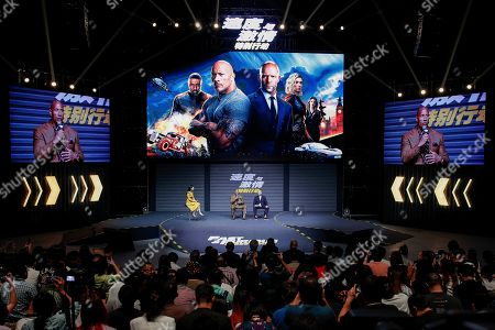 Jason Statham, Dwayne Johnson. Actors Jason Statham, right, and Dwayne Johnson speak on stage during a press conference ahead of the premiere of 'Fast & Furious: Hobbs & Shaw' in Beijing