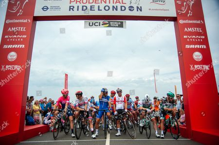 Philippe Gilbert of Team Deceuninck-Quick-Step, centre left, and Caleb Ewan of Lotto Soudal, centre right, before the start of the race on Chestnut Avenue in Bushy Park near Hampton Court Palace in Surrey at the start of Prudential RideLondon-Surrey Classic.