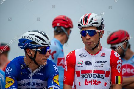 Philippe Gilbert of Team Deceuninck-Quick-Step, left, and Caleb Ewan of Lotto Soudal, right, before the start of the race on Chestnut Avenue in Bushy Park near Hampton Court Palace in Surrey at the start of Prudential RideLondon-Surrey Classic.