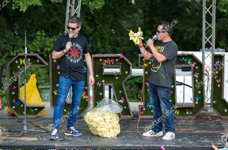 Stock Photo of Dick and Dom giving away Toymaster merchandise on stage