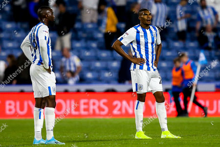 Collin Quaner of Huddersfield Town and Isaac Mbenza of Huddersfield Town cut dejected figures