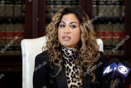 Gloria Allred, Lizzette Martinez. Lizzette Martinez one of R&B singer R. Kelly's alleged victims speaks in the offices of her attorney Gloria Allred, in Los Angeles