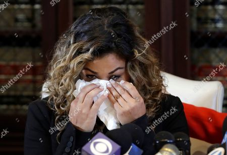 Lizzette Martinez,one of R&B singer R. Kelly's alleged victims, wipes tears from her face as she speaks during a news conference in the offices of attorney Gloria Allred, in Los Angeles