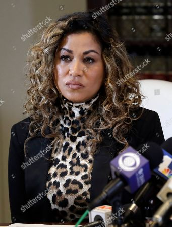 Lizzette Martinez, one of R&B singer R. Kelly's alleged victims, sits in a conference room during a news conference in the offices of attorney Gloria Allred, in Los Angeles