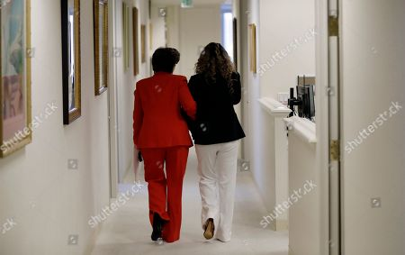 Gloria Allred, Lizzette Martinez. Attorney Gloria Allred, left, walks with Lizzette Martinez, one of R&B singer R. Kelly's alleged victims, after a news conference, in Los Angeles