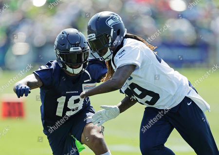 Seattle Seahawks wide receiver Keenan Reynolds, right, runs a drill with outside linebacker Shaquem Griffin, right, during NFL football training camp, in Renton, Wash
