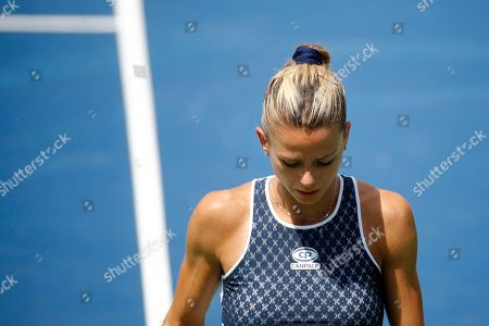 Camila Giorgi, of Italy, walks on the court during a final match against Jessica Pegula at the Citi Open tennis tournament, in Washington