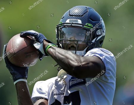 Seattle Seahawks cornerback Tre Flowers makes a catch during NFL football training camp, in Renton, Wash