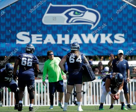 Seattle Seahawks guards Jordan Roos (64) and Jordan Simmons (66) take part in a drill during NFL football training camp, in Renton, Wash
