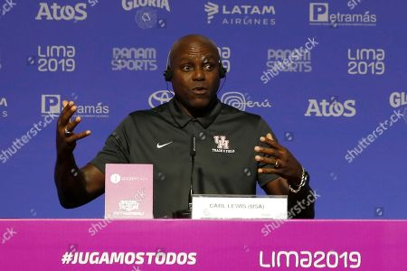 Nine-time Olympic gold medalist Carl Lewis, from the United States, speaks during a press conference during the Pan American Games in Lima, Peru,. Lewis said that if it wasn't for his mother, who competed in the first Pan Am Games in 1951, he would have never chosen athletics