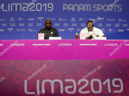 Olympics medalist Carl Lewis, left, and Leroy Burrell, both from the United States, give a press conference during the Pan American Games in Lima, Peru,. Lewis said that if it wasn't for his mother, who competed in the first Pan Am Games in 1951, he would have never chosen athletics