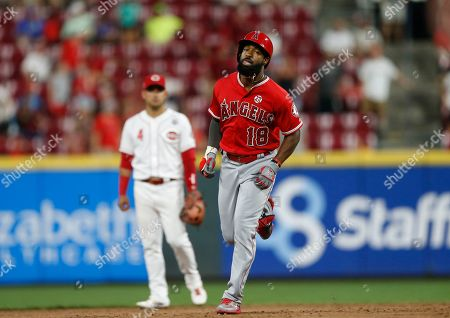 Los Angeles Angels' Brian Goodwin (18) rounds the bases with a two-run homer off Cincinnati Reds relief pitcher David Hernandez, as Matt Thaiss (23) waits with congratulations during the ninth inning of a baseball game, in Cincinnati