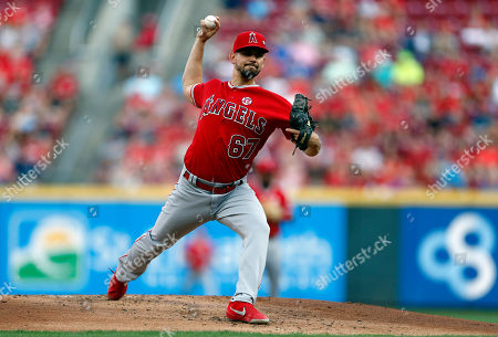 Los Angeles Angels starting pitcher Taylor Cole throws against the Cincinnati Reds during the first inning of a baseball game, in Cincinnati