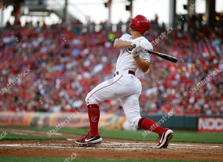 Cincinnati Reds' Nick Senzel hits a two-run single off Los Angeles Angels relief pitcher Taylor Cole during the first inning of a baseball game, in Cincinnati
