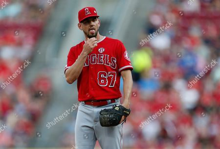 Los Angeles Angels starting pitcher Taylor Cole reacts to giving up five runs during the fifth inning of a baseball game against the Cincinnati Reds, in Cincinnati
