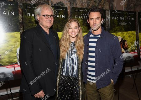 "Stock Photo of Simon Curtis, Amanda Seyfried, Milo Ventimiglia. Director Simon Curtis, left, poses with actors Amanda Seyfried and Milo Ventimiglia at a special screening of ""The Art of Racing in the Rain"" at The Whitby Hotel, in New York"