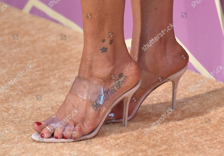 Poppy Montgomery, shoe and tattoo detail