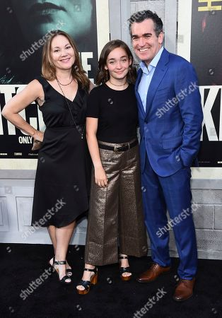 """Brian d'Arcy James, Jennifer Prescott, Grace James. Brian d'Arcy James, right, wife Jennifer Prescott, from left, and daughter Grace James arrive at the world premiere of """"The Kitchen"""" at the TCL Chinese Theatre, in Los Angeles"""