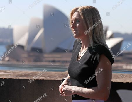 Stock Image of Australian athlete Sally Pearson poses for a photo after announcing her retirement in Sydney, Australia, . Pearson, who won the 100-meter hurdles gold medal at London in 2012 in an Olympic record time despite the rain, has retired from competitive track and field after a series of injuries