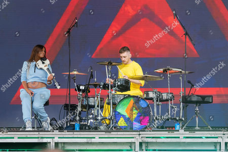 Musician Luke Patterson performs with Clean Bandit on the main stage