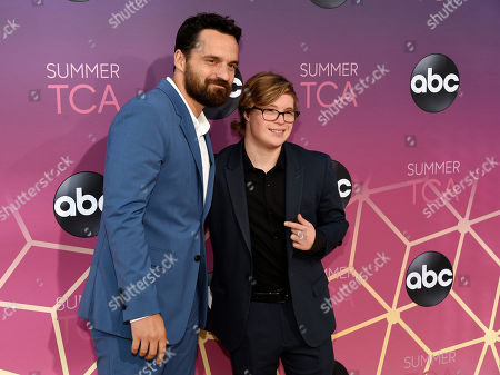 """Stock Image of Jake Johnson, Cole Sibus. Jake Johnson, left, and Cole Sibus, cast members in the ABC series """"Stumptown,"""" pose together at the ABC Television Critics Association Summer Press Tour All-Star Party at Soho House, in West Hollywood, Calif"""