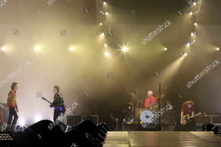 Mick Jagger, Ronnie Wood, Charlie Watts, Keith Richards. Mick Jagger, from left, Ronnie Wood, Charlie Watts and Keith Richards of The Rolling Stones perform at MetLife Stadium, in East Rutherford, N.J