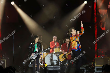 Ronnie Wood, Charlie Watts, Keith Richards, Mick Jagger. Ronnie Wood, from left, Charlie Watts, Keith Richards and Mick Jagger of The Rolling Stones perform at MetLife Stadium, in East Rutherford, N.J