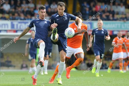 Stock Image of Liam Ridgewell (L) and Harry Lennon (R) of Southend United in action during the Sky Bet One match between Southend United and Blackpool at Roots Hall in Southend, UK. 10th August 2019