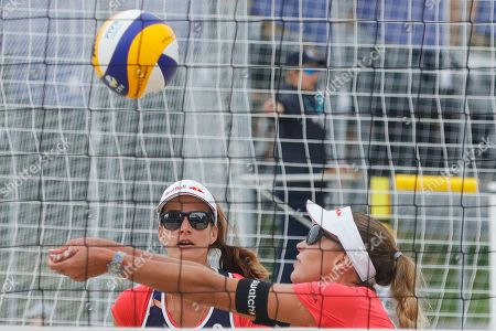 Anouk Verge-Depre, Joana Heidrich. Switzerland's Joana Heidrich, center, and Anouk Verge-Depre play the pall during their match against Germany's Laura Ludwig and Margareta Kozuch at the Beach Volleyball European Championship in Moscow, Russia