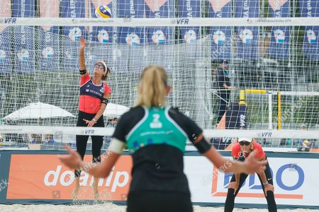 Anouk Verge-Depre, Joana Heidrich, Margareta Kozuch. Switzerland's Joana Heidrich, left, and Anouk Verge-Depre play the pall during their match against Germany's Laura Ludwig, not in the picture, and Margareta Kozuch, center, at the Beach Volleyball European Championship in Moscow, Russia