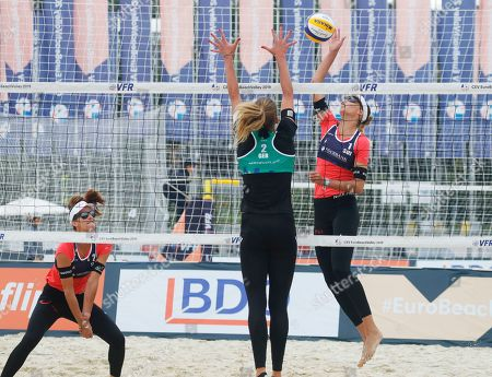 Anouk Verge-Depre, Joana Heidrich, Margareta Kozuch. Switzerland's Joana Heidrich, left, and Anouk Verge-Depre, right, play the pall during their match against Germany's Laura Ludwig, not in the picture, and Margareta Kozuch, center, at the Beach Volleyball European Championship in Moscow, Russia