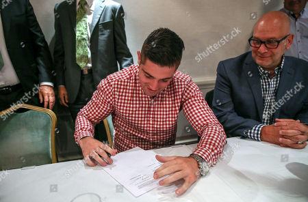 Joe Ward and Lou DiBella of DiBella Entertainment sign his first professional contract