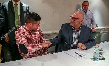 Stock Picture of Joe Ward and Lou DiBella of DiBella Entertainment sign his first professional contract