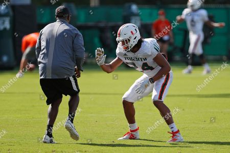 Stock Picture of Miami cornerback Christian Williams runs a drill during an NCAA college football practice at the University of Miami Greentree Practice Field, in Coral Gables, Fla