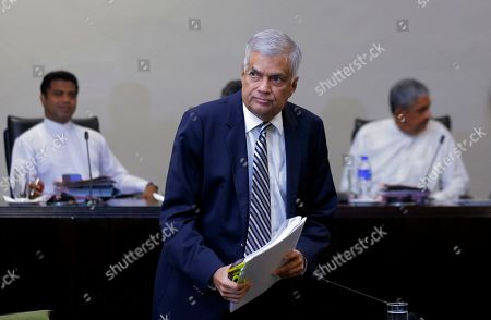 Sri Lankan Prime Minister Ranil Wickremesinghe leaves after testifying in front of a parliamentary committee investigating the Islamic State-inspired Easter Sunday bomb attacks, at the parliament complex in Colombo, Sri Lanka, . Wickremesinghe said the coordinated suicide bomb attacks in three churches and three tourist hotels on April 21 were the result of the security apparatus failing to follow the transition of religious extremists into terrorists, adding that the country should prepare itself to face new forms of terrorism prevalent in other countries