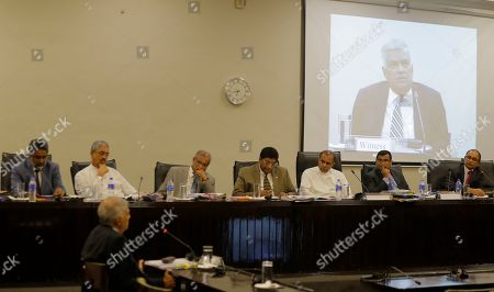 Sri Lankan Prime Minister Ranil Wickremesinghe testifies in front of a parliamentary committee investigating the Islamic State-inspired Easter Sunday bomb attacks, at the parliament complex in Colombo, Sri Lanka, . Wickremesinghe said the coordinated suicide bomb attacks in three churches and three tourist hotels on April 21 were the result of the security apparatus failing to follow the transition of religious extremists into terrorists, adding that the country should prepare itself to face new forms of terrorism prevalent in other countries