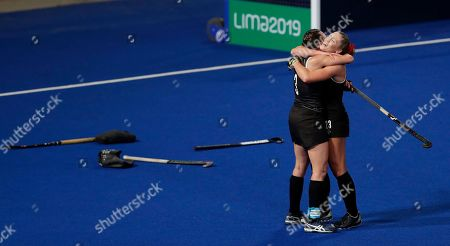 Canada's players Katherine Wright, left, and Brienne Stairs celebrate after winning the women's field hockey semifinal match against the United States at the Pan American Games in Lima, Peru, . Canada won 2-0