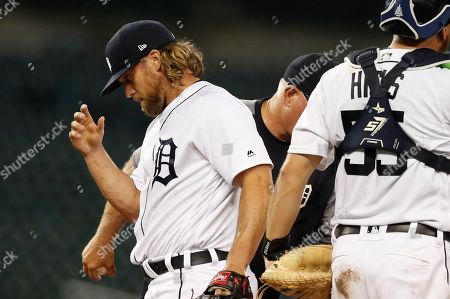 Detroit Tigers relief pitcher Trevor Rosenthal is removed during the eighth inning of the second game of the baseball team's doubleheader against the Chicago White Sox, in Detroit