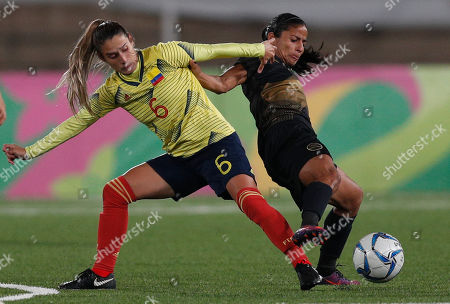 Daniela Montoya of Colombia, left, battles for the ball with Shirley Cruz of Costa Rica during a women' soccer semifinal soccer match at the Pan American Games in Lima Peru