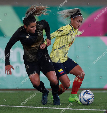Jessica Caro of Colombia, right, is challenged by Raquel Rodriguez of Costa Rica during the women's semifinal soccer match at the Pan American Games in Lima Peru