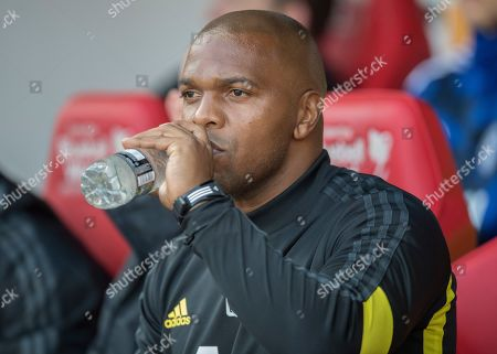 Quinton Fortune assistant coach of Manchester United U21 sits in the dug out