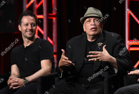 """Dave Andron, Walter Mosley. Dave Andron, left, co-creator/showrunner/executive producer/writer of the FX series """"Snowfall,"""" and consulting producer/writer Walter Mosley take part in a panel discussion during the 2019 Television Critics Association Summer Press Tour, in Beverly Hills, Calif"""