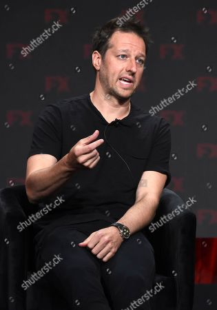 """Dave Andron, the co-creator/showrunner/executive producer/writer of the FX series """"Snowfall,"""" answers a question during the 2019 Television Critics Association Summer Press Tour, in Beverly Hills, Calif"""